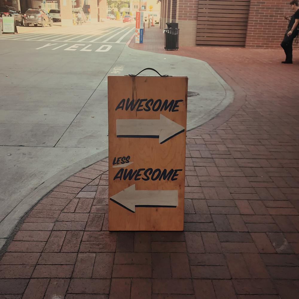 photo of a sign that says awesome / not awesome